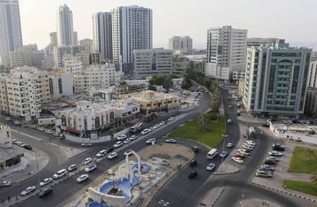 Building for Sale in Al Rashidiya, Ajman - COMMERCIAL VILLA FOR SALE ON MAIN ROAD IN AJMAN