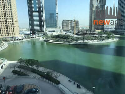 Office for Rent in Jumeirah Lake Towers (JLT), Dubai - Lavishly Fitted Office With 3 Glass Cabins And Lake View