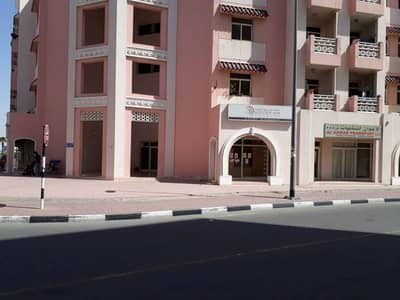 Studio with balcony in China cluster International city Dubai Rent 28000 by 1 payments