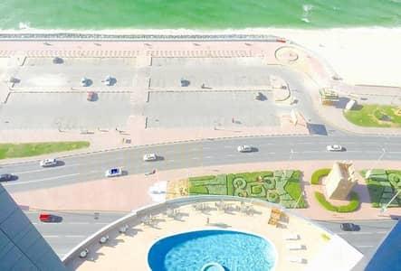2 Bedroom Flat for Sale in Corniche Ajman, Ajman - HUGE FULLY SEA VIEW 2 BEDROOM  HALL  MAID ROOM  2 BALCONY FLAT FOR SALE IN CORNICHE TOWERS