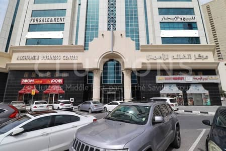 Office for Rent in Al Majaz, Sharjah - Mid floor proper size office with parking