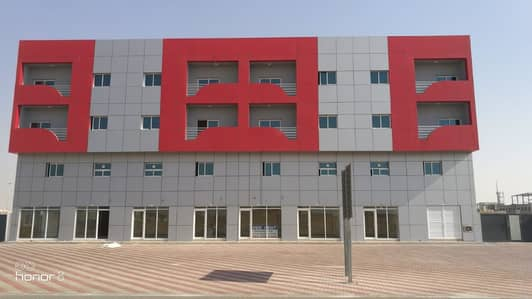 1 Bedroom Apartment for Rent in Emirates Modern Industrial Area, Umm Al Quwain - Main Building Tower
