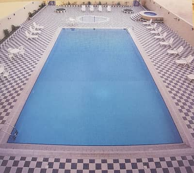 chiller free gym pool free 2bhk with balcony 3 washroom  maids room opp sahara center in al nahda