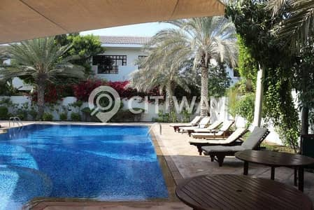 Stunning two-story villa with spacious garden and pool area