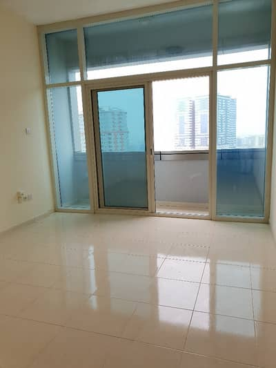 Specious studio with balcony rent 23k only 6 cheques no deposit in al nahda area.