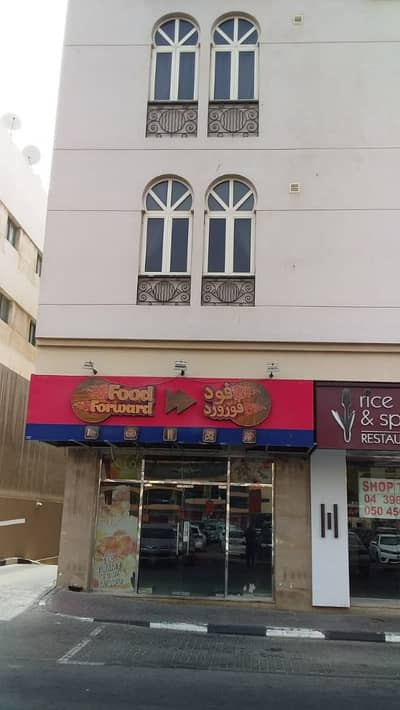 Shop for Rent in Bur Dubai, Dubai - Amal Baqir Building -Shop available