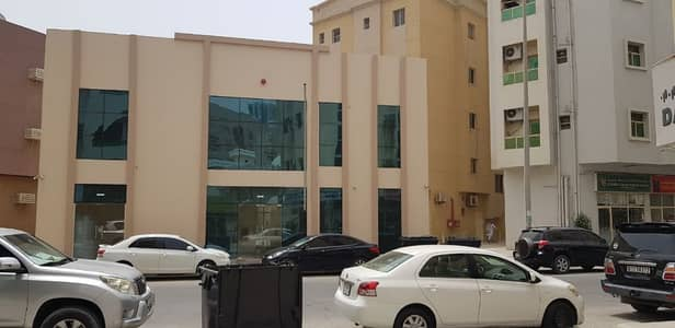 Building for Sale in Al Nakhil, Ajman - HUGE COMMERCIAL BUILDING WITH SHOWROOM WITH TWO FLOOR///