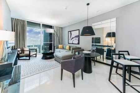 فلیٹ 2 غرفة نوم للايجار في شارع الشيخ زايد، دبي - Lavish Fully Furnished and Serviced Apt. with SZR view