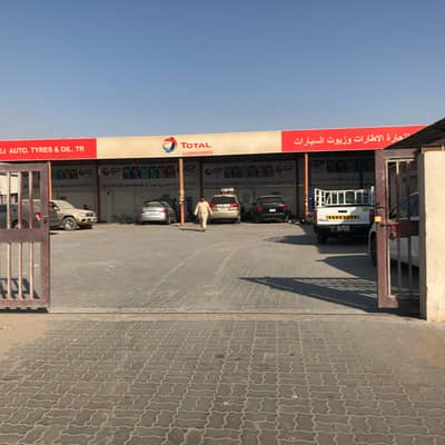 Industrial Land for Rent in Industrial Area, Sharjah - Yard For Rent with Auto. Maint. Facility Available.