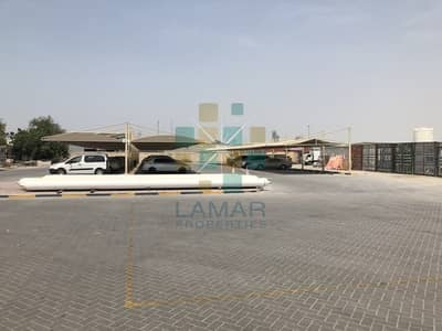 Plot for Rent in Al Quoz, Dubai - com land near sheikh zayed road interlocked with wall
