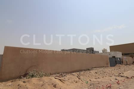 Plot for Rent in Emirates Industrial City, Sharjah - Fenced spacious plot in Sajaa