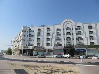 مکتب  للايجار في القصيص، دبي - Spacious Office Space with Parking and Window A/C | Al Qusais