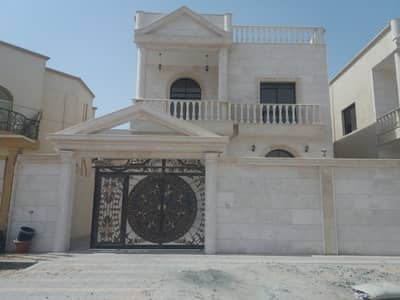 Villa in Ajman for sale free ownership faced stone with decorations