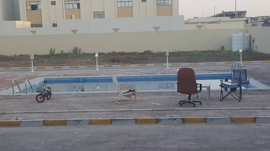 Big and Nice studio in Khalifa City A with balcony and sharing swimming pool.