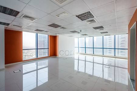 Office for Rent in Jumeirah Lake Towers (JLT), Dubai - Semi Fitted Office I Mid Floor I Freezone