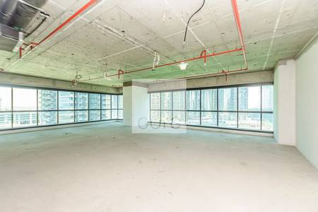 Office for Sale in Jumeirah Lake Towers (JLT), Dubai - Well-lit shell and core office in JBC 1