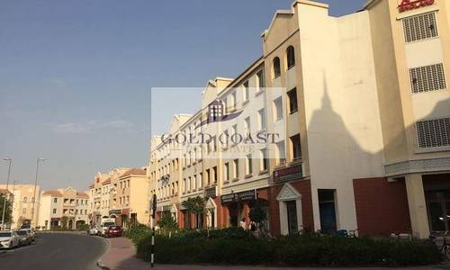 Shop for Rent in International City, Dubai - Fitted Shop in England Cluster for Rent for multiple cheques