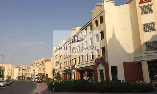 محل تجاري  للايجار في المدينة العالمية، دبي - Fitted Shop in England Cluster for Rent for multiple cheques