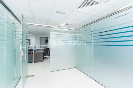 Office for Sale in Jumeirah Lake Towers (JLT), Dubai - Spacious fitted office unit on mid floor
