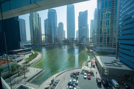 Office for Rent in Jumeirah Lake Towers (JLT), Dubai - Open Plan Lake View Fitted office at Indigo Icon