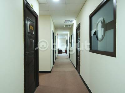 Office for Rent in Al Khabisi, Dubai - OFFICE FOR RENT CLOSE TO METRO STATION WITH FREE UTILITIES
