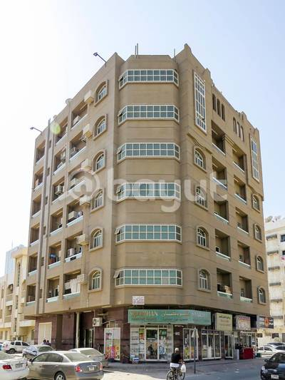 1 Bedroom Apartment for Rent in Al Rumaila, Ajman - One bed room And Hall In Rumaila - Ajman - Local Building