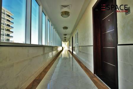2 Bedroom Flat for Rent in Dubai Studio City, Dubai - Roof Top Pool - December - Modern Finish