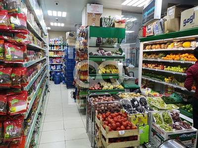 Shop for Sale in Al Mamzar, Sharjah - Main Road | Supermarket  | Parking Area | Full Services
