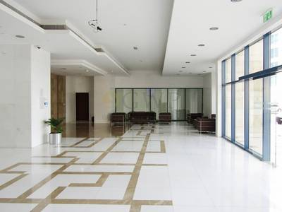 Office for Sale in Jumeirah Lake Towers (JLT), Dubai - Fitted rented office full Lake view great price and great return