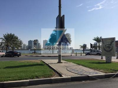 Building for Sale in Corniche Al Buhaira, Sharjah - TOWER FACING THE BUHAIRA CORNICHE AND RESIDENTIAL COMMUNITY