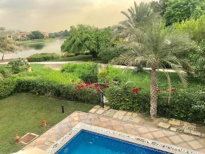4 Bedroom Villa for Rent in Jumeirah Islands, Dubai - Garden Hall 4BR w/ Lake view Oasis Style