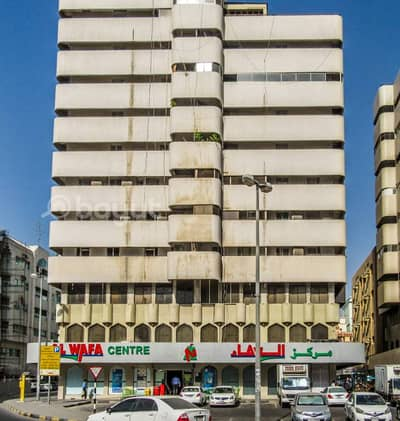 2 Bedroom Apartment for Rent in Al Shuwaihean, Sharjah - 2 B/R HALL FLAT WITH SPLIT DUCTED A/C IN AL WAFA CENTER BUILDING