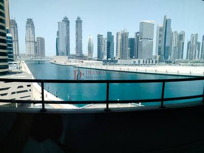 Office for Rent in Business Bay, Dubai - 1 Month Free| Spacious Fitted Office with Balcony|Canal View