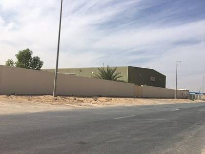 Warehouse for Rent in Emirates Industrial City, Sharjah - 128k sqft boundary wall with 16000sqft warehouse for rent