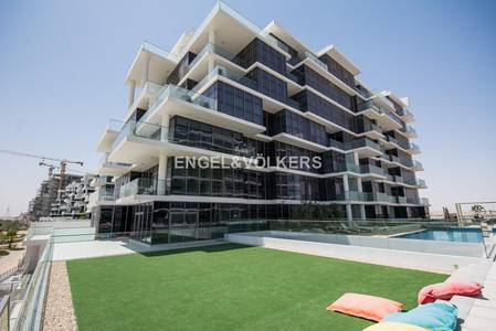 Studio for Rent in DAMAC Hills (Akoya by DAMAC), Dubai - Pool and golf course view   Appliances