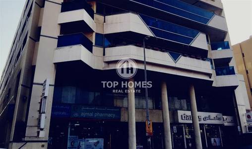 Building for Rent in Bur Dubai, Dubai - Karama Building shops for rent