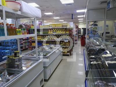 Shop for Rent in Al Mamzar, Sharjah - Big Supermarket | Main Road | Free Parking Area