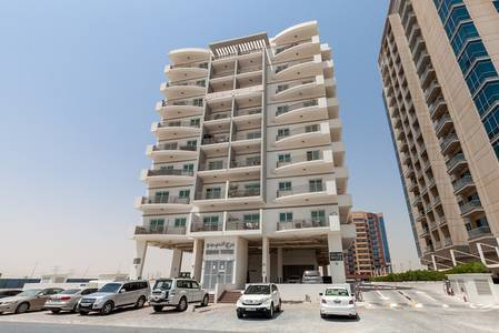 1 Bedroom Flat for Rent in Dubai Residence Complex, Dubai - Rent Reduced -Chiller Free units with Balcony