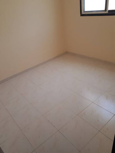 1 Bedroom Apartment for Rent in Bu Tina, Sharjah - BRAND NEW 1 BEDROOM HALL FOR RENT