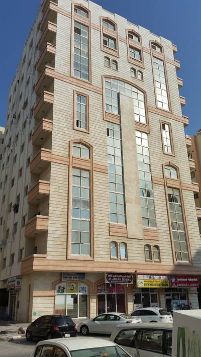Building for Sale in King Faisal Street, Ajman - BUILDING FOR SALE 12% RIO