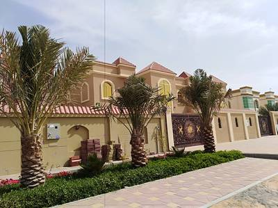 5 Bedroom Villa for Sale in Al Rawda, Ajman - Villa for sale the second part of the street finishing Super Deluxe