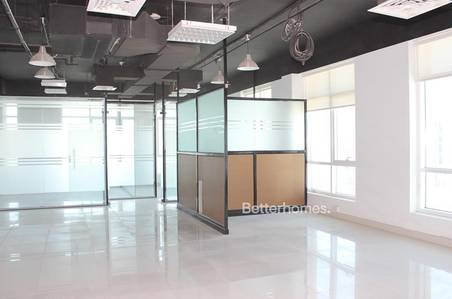 Office for Rent in Motor City, Dubai - Fitted | 2 Parking | Partitioned