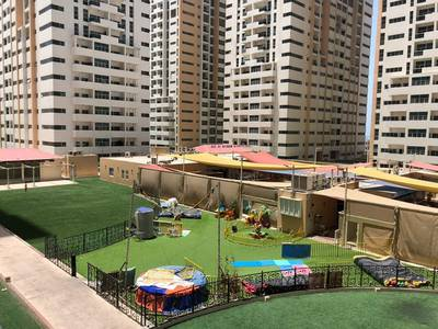 1 Bedroom Apartment for Rent in Al Sawan, Ajman - 1 bhk closed kitchen garden view  in Ajman one tower