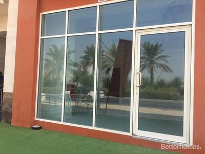 Shop for Rent in Jumeirah Village Circle (JVC), Dubai - Retail Ground Floor Residential Building