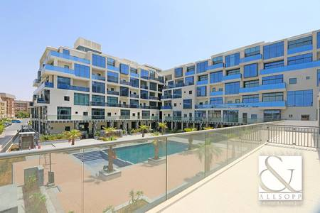 4 Bedroom Flat for Rent in Motor City, Dubai - Pool View | Large Terrace | Duplex Unit