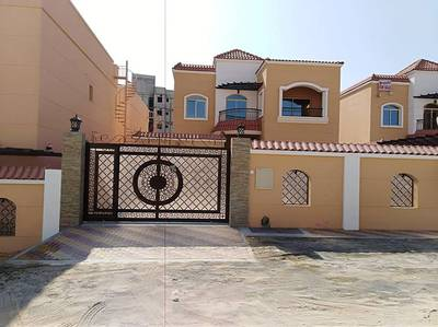 5 Bedroom Villa for Sale in Al Zahraa, Ajman - For sale a very luxurious villa faced with a large building area of high-class decorations at the hi