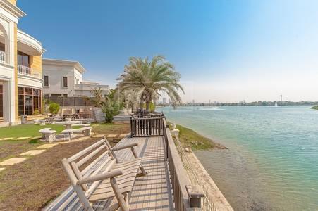 فیلا 9 غرفة نوم للايجار في تلال الإمارات، دبي - Lake & Golf Course View | Fully Furnished Custom-Built Villa