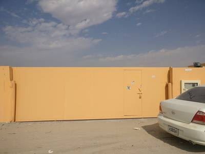 Industrial Land for Rent in Al Saja, Sharjah - 30 kw power 20000 sqft open yard office shed concrete floor boundary wall in saja sharjah