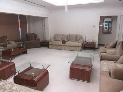7 Bedroom Villa for Rent in Al Qadisiya, Sharjah - Luxurious 7 BHK D/s Villa on main road with 4 master rooms, 2 majlis, living dining, 2 maidrooms,
