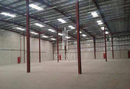 Warehouse for Sale in Dubai Investment Park (DIP), Dubai - Warehouse | Well-maintained | Road Views
